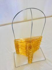 Goldene Kleiderbügel