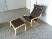 Sessel mit Fußteil aus Holz -