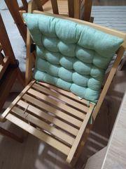 IKEA Klappstuhl mit grünem Sitzkissen