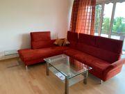 Sofalandschaft Wohnzimmer orange-rot