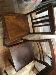 4 alte Holzstühle