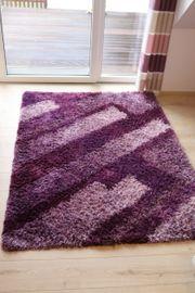 Handgetuftet Hochflorteppich violett 140 x