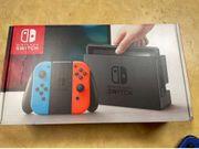 Nintendo Switch mit drei Spielen