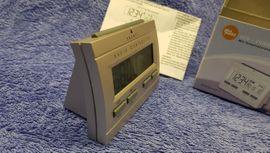 LCD Funkwecker Uhr silber OV: Kleinanzeigen aus Leverkusen - Rubrik Uhren