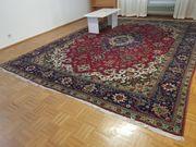 2 verschiedene handgeknüpfte Teppiche