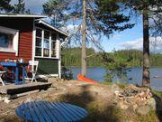 Haus mit Kanu und Traumlage