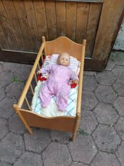 Puppenwagen Puppenbett und Puppentrage
