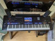 Yamaha genos keyboard with stand