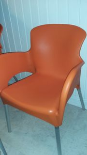 4 orange Schalensessel Kunststoff Alu