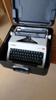 Schreibmaschine Olympia Monika mit Koffer