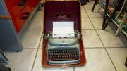 Antike Schreibmaschine Alpina mit Koffer