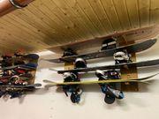13 Snowboards und 32 Paar