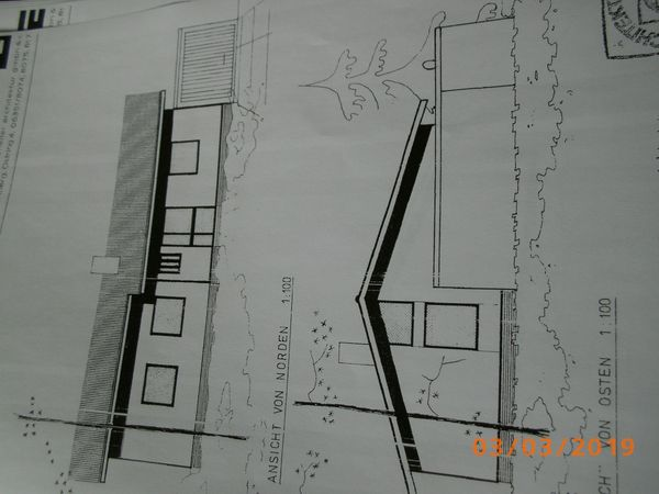 Handwerker für Holz Fassade Sockel-Verputzarbeiten
