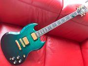 Gibson SG Supreme Emerald Burst