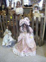 4 schöne große Puppen mit Porzellanköpfen