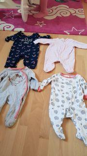 4 Babystrampler