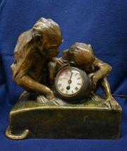 Affen Uhr Bronze signiert M