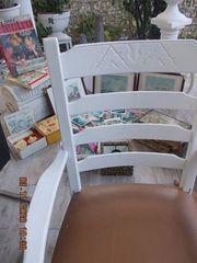 älterer breiter stabiler Holzstuhl Sessel