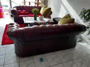 Zwei Dreisitzer Sofas