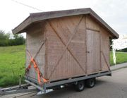 Tiny Haus aus Massivholz Balken