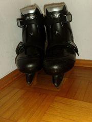 schwarze Kinderschlittschuhe Trex Größe 34