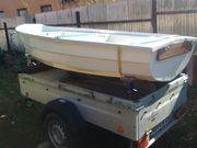 Ruderboot mit Slipwagen