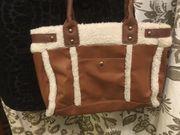 Winterhandtasche mit Leder und Fell