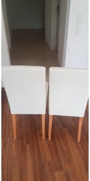 4 weiße Lederstühle