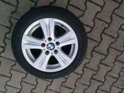 Alufelgen 1-er BMW mit Winterreifen