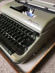 Olympia Schreibmaschine im Koffer Retro