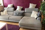 Sofa mit Ottomane grau