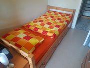 Jugendbett mit praktischen Bettkästen