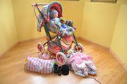 Puppenwagen mit viel Zubehör und