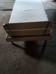 Gebrauchtes Bett in Ahorn-Optik abzugeben