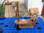 Holzschiff mit Lampe und Spieluhr