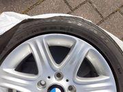 Verkaufe BMW-Alufelgen gelaufen auf einem