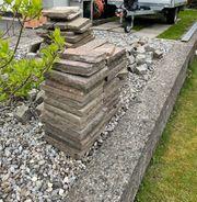 Granitsteine und Porphyrplatten