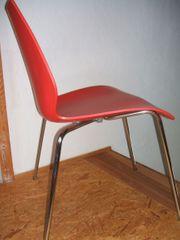 2 rote MAUI Stühle