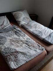 1 Bett mit Rattan und