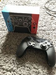 Nintendo Switch Neon-Rot - 2 Spiele