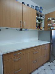 NOLTE-Küche mit SIEMENS-Geräten Vollauszugsschränken Dekor