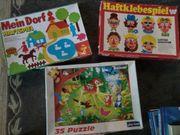 Puzzle und Haftklebespiele