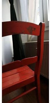 Gebrauchter Holzstuhl in Orange