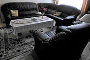 Ledersofa schwarz zugehöriger Sessel L-Couch