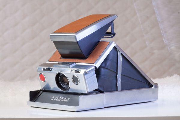 Polaroid SX 70 mit Ledertasche