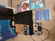 Playstation 4 mit 4 Spiele