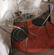 Runder Glastisch mit 4 Stühlen