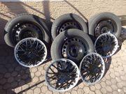 4 Winterreifen Bridgestone Radkappen für