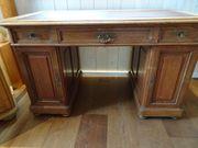 Schreibtisch antik Vollholz mit Lederintarsie