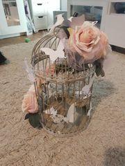 2 Käfige mit künstlichen Blumen